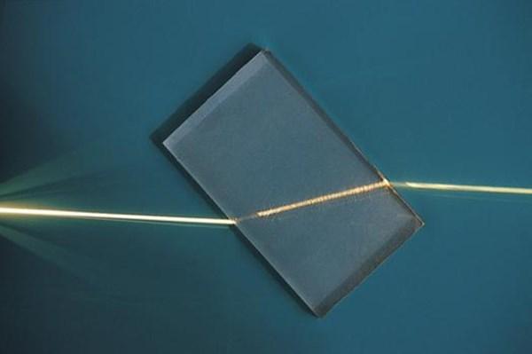 Light refraction through a plastic block.